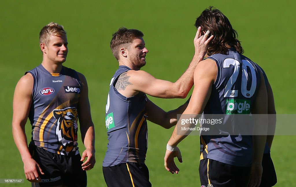Ivan Maric gets his ear flicked by Ricky Petterd as punishment for dropping a mark during a Richmond Tigers AFL training session at ME Bank Centre on May 2, 2013 in Melbourne, Australia.