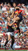 Ivan Maric of the Crows wins the ball over Dean Brogan of the Power during the round six AFL match between the Adelaide Crows and the Port Adelaide...