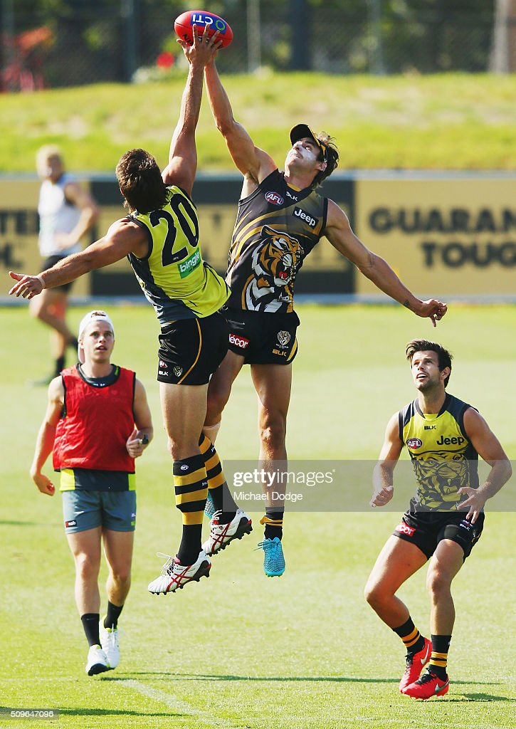 Ivan Maric of the Tigers (L) and Ben Griffiths of the Tigers compete for the ball in the ruck contest during the Richmond Tigers AFL intra-club match at Punt Road Oval on February 12, 2016 in Melbourne, Australia.
