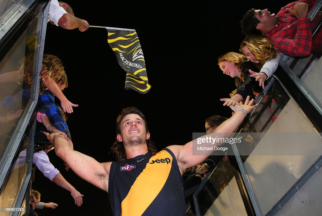 Ivan Maric of the Tigers celebrates his 100th game with the fans round two AFL match between the St Kilda Saints and the Richmond Tigers at Melbourne Cricket Ground on April 5, 2013 in Melbourne, Australia.