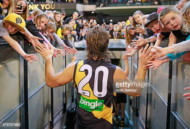 Ivan Maric of the Tigers celebrates with supporters in the crowd after winning the round seven AFL match between the Richmond Tigers and the...