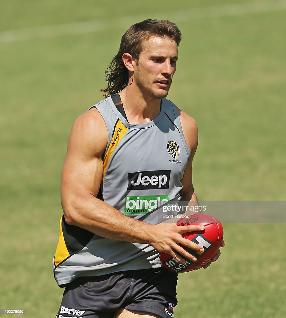 Ivan Maric of the Tigers runs with the ball during a Richmond Tigers AFL training session at ME Bank Centre on March 7, 2013 in Melbourne, Australia.