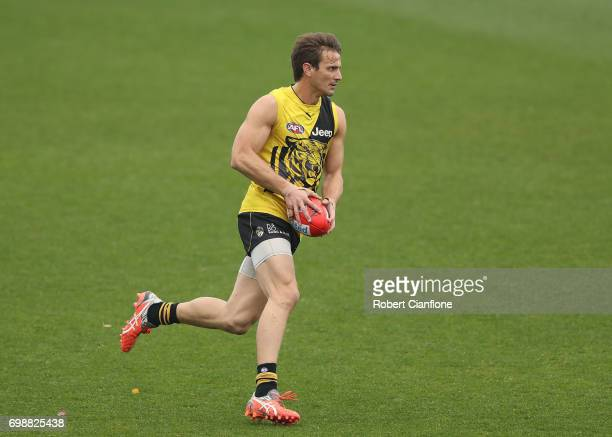 Ivan Maric of the Tigers runs with the ball during a Richmond Tigers AFL training session at Punt Road Oval on June 21 2017 in Melbourne Australia