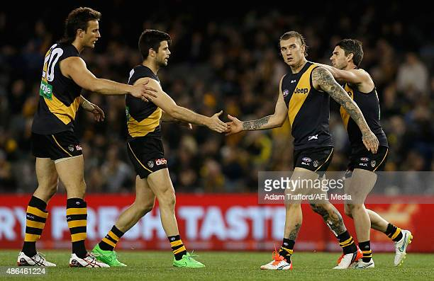 Ivan Maric Trent Cotchin Dustin Martin and Chris Newman of the Tigers celebrate a goal during the 2015 AFL round 23 match between the Richmond Tigers...