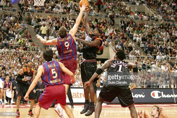 Ivan McFarlin of the Philadelphia 76ers shoots against Dennis Marconato of Winterthur FC Barcelona during NBA Europe Live presented by EA Sports on...