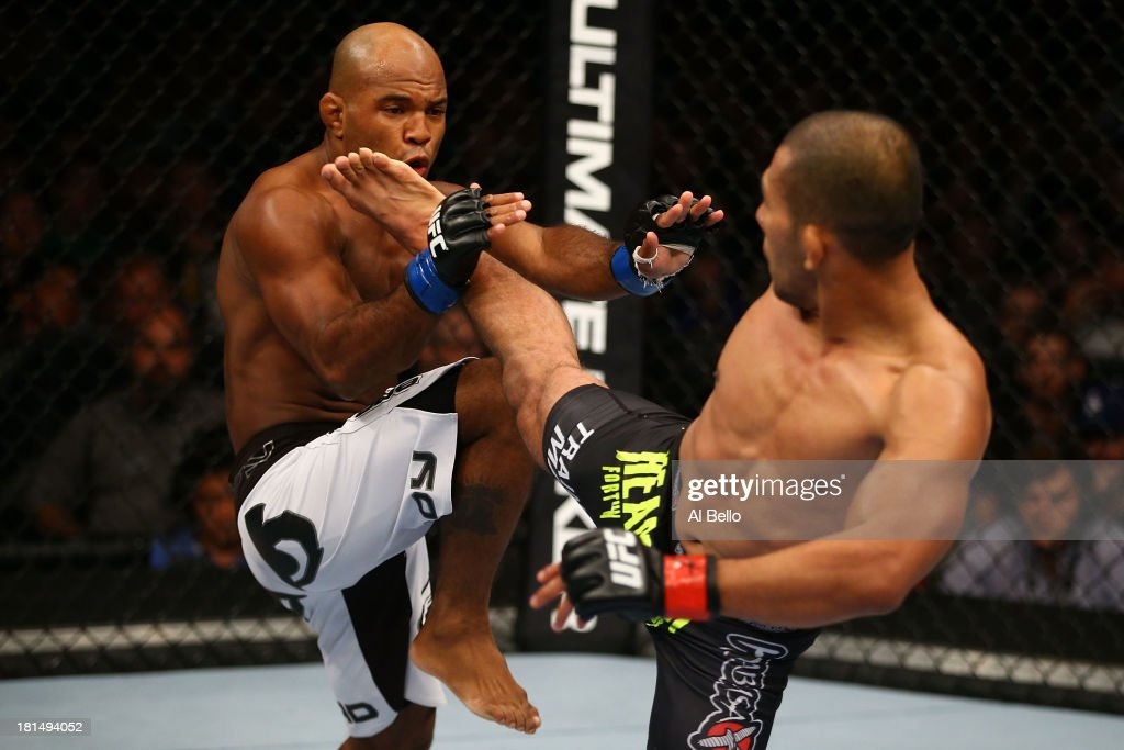 Ivan Menjivar kicks Wilson Reis in their UFC bantamweight bout at the Air Canada Center on September 21, 2013 in Toronto, Ontario, Canada.