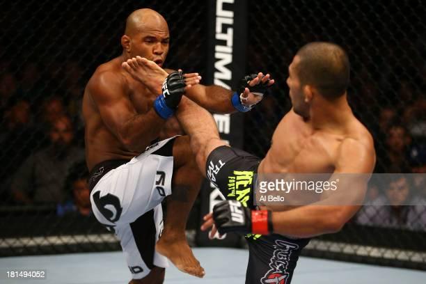Ivan Menjivar kicks Wilson Reis in their UFC bantamweight bout at the Air Canada Center on September 21 2013 in Toronto Ontario Canada