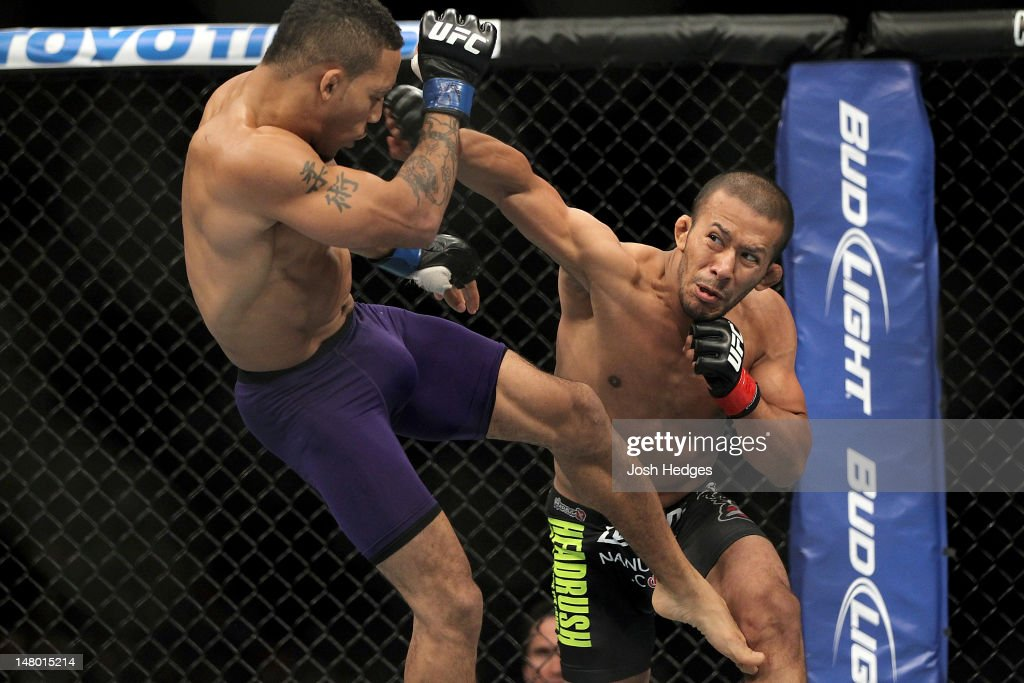 Ivan Menjivar punches Mike Easton during their bantamweight bout at UFC 148 inside MGM Grand Garden Arena on July 7, 2012 in Las Vegas, Nevada.