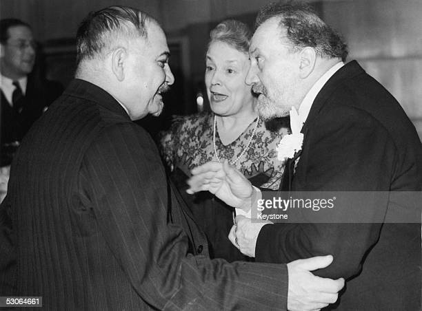 Ivan Mikhailovich Maisky the Soviet Ambassador to Britain chats with conductor Sir Henry Wood and Lady Wood at a party held by the BBC to commemorate...