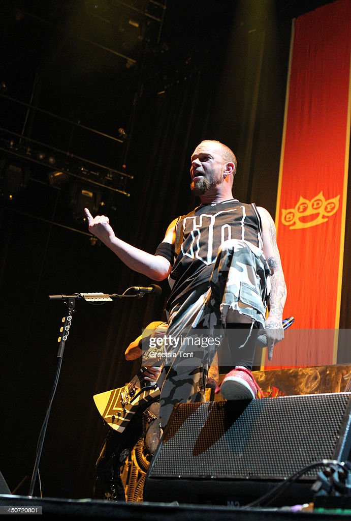 Ivan Moody of Five Finger Death Punch performs supporting Avenged Sevenfold at the Ziggo Dome on November 19, 2013 in Amsterdam, Netherlands.
