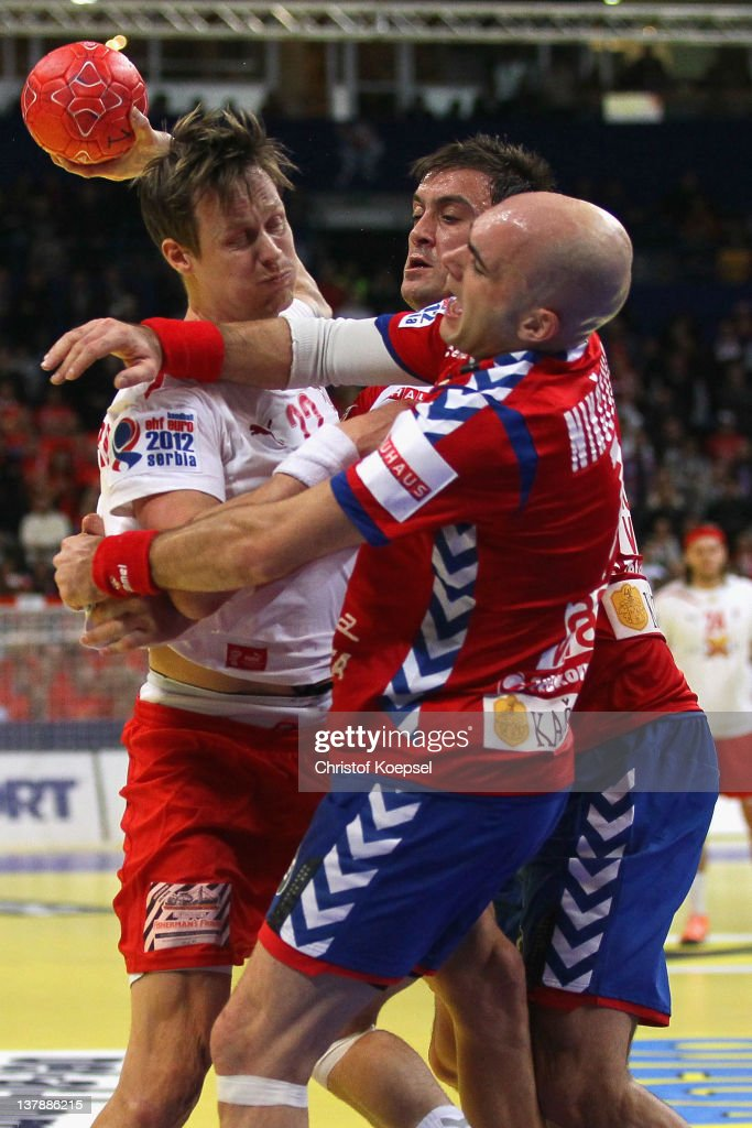 Ivan Nikcevic of Serbia and Momir Ilic of Serbia defend against Kasper Soendergaard Sarup of Denmark during the Men's European Handball Championship...