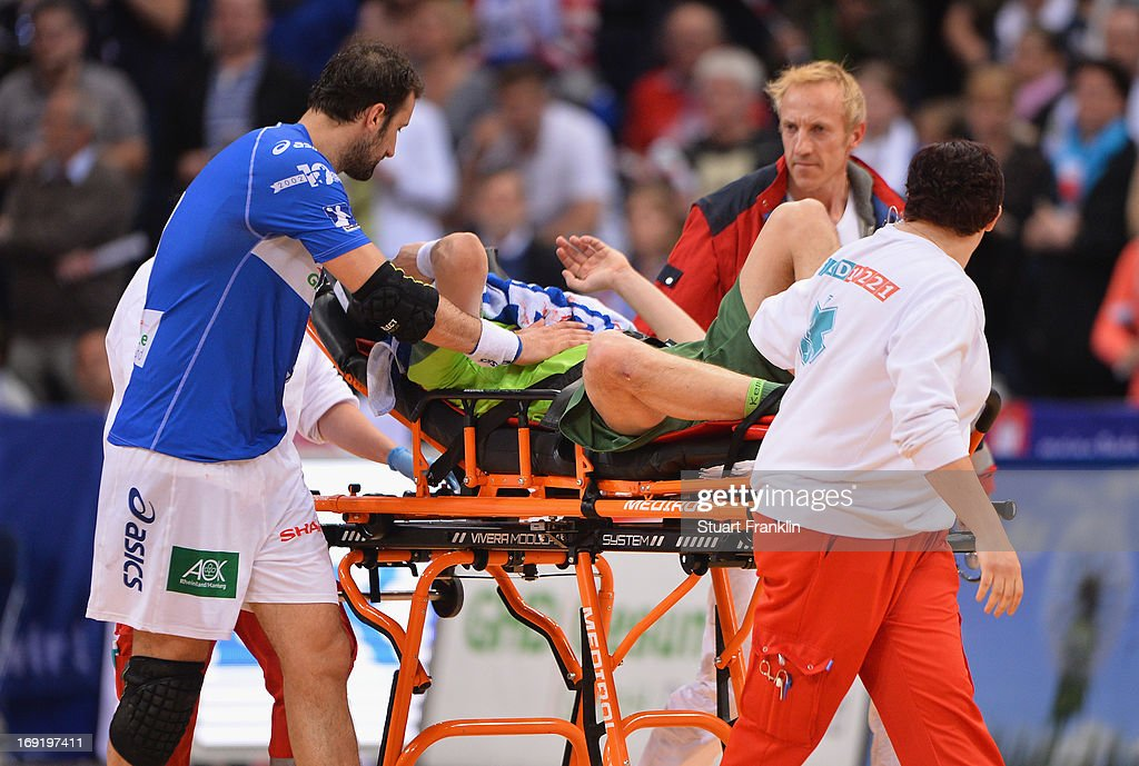 Ivan Nincevic of Berlin receives treatment for a serious injury during the DKB Bundeliga match between HSV Hamburg and Fuechse Berlin at O2 World on May 21, 2013 in Hamburg, Germany.