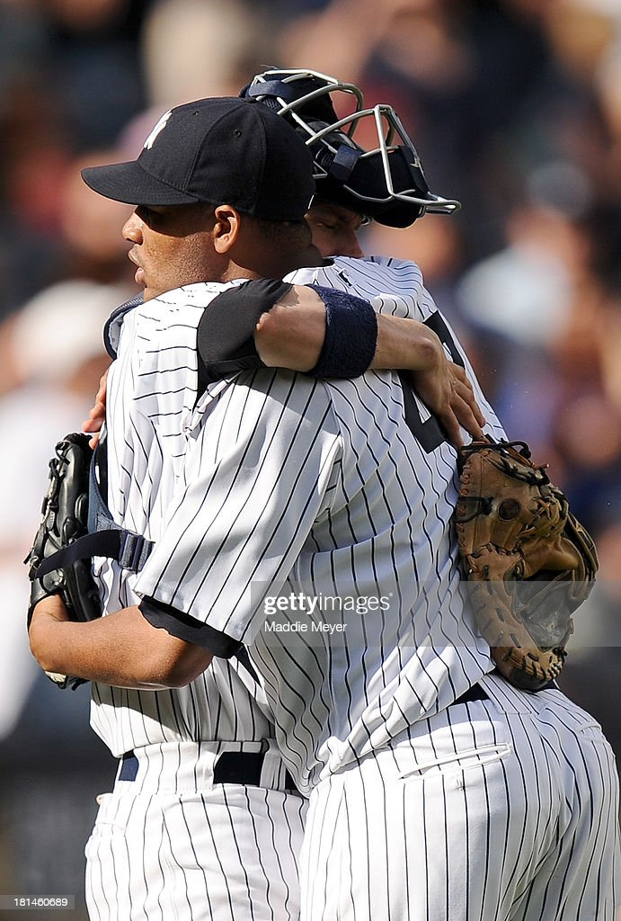 <a gi-track='captionPersonalityLinkClicked' href=/galleries/search?phrase=Ivan+Nova&family=editorial&specificpeople=5743486 ng-click='$event.stopPropagation()'>Ivan Nova</a> #47 of the New York Yankees celebrates a win over the San Francisco Giants with Chris Stewart #19 during interleague play on September 21, 2013 at Yankee Stadium in the Bronx borough of New York City. The Yankees defeat the Giants 6-0.