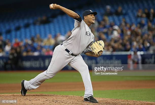 Ivan Nova of the New York Yankees delivers a pitch in the eighth inning during MLB game action against the Toronto Blue Jays on April 13 2016 at...