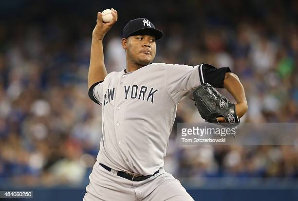 Ivan Nova of the New York Yankees delivers a pitch in the fourth inning during MLB game action against the Toronto Blue Jays on August 14 2015 at...
