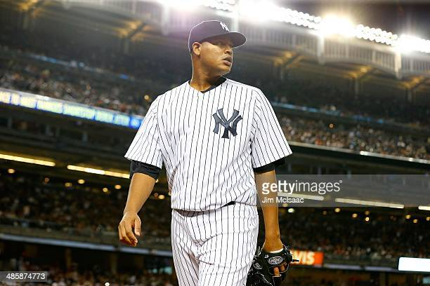Ivan Nova of the New York Yankees in action against the Boston Red Sox at Yankee Stadium on April 13 2014 in the Bronx borough of New York City The...