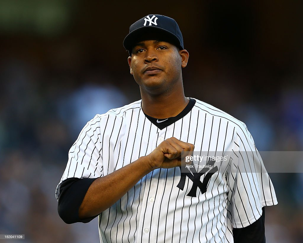 <a gi-track='captionPersonalityLinkClicked' href=/galleries/search?phrase=Ivan+Nova&family=editorial&specificpeople=5743486 ng-click='$event.stopPropagation()'>Ivan Nova</a> #47 of the New York Yankees is pulled from the game in the seventh inning against the Tampa Bay Rays on September 15, 2012 at Yankee Stadium in the Bronx borough of New York City.