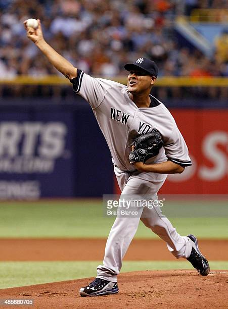 Ivan Nova of the New York Yankees pitches during the first inning of a game against the Tampa Bay Rays on April 19 2014 at Tropicana Field in St...