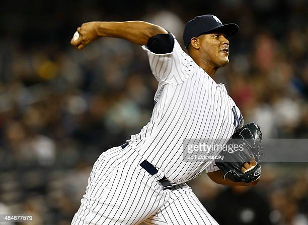 Ivan Nova of the New York Yankees pitches in the first inning against the Boston Red Sox at Yankee Stadium on April 13 2014 in the Bronx Borough of...