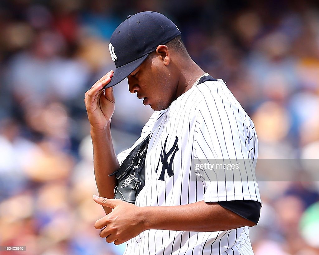 <a gi-track='captionPersonalityLinkClicked' href=/galleries/search?phrase=Ivan+Nova&family=editorial&specificpeople=5743486 ng-click='$event.stopPropagation()'>Ivan Nova</a> #47 of the New York Yankees reacts after walking Edwin Encarnacion of the Toronto Blue Jays to load the bases in the sixth inning against the Toronto Blue Jays on August 8, 2015 at Yankee Stadium in the Bronx borough of New York City.