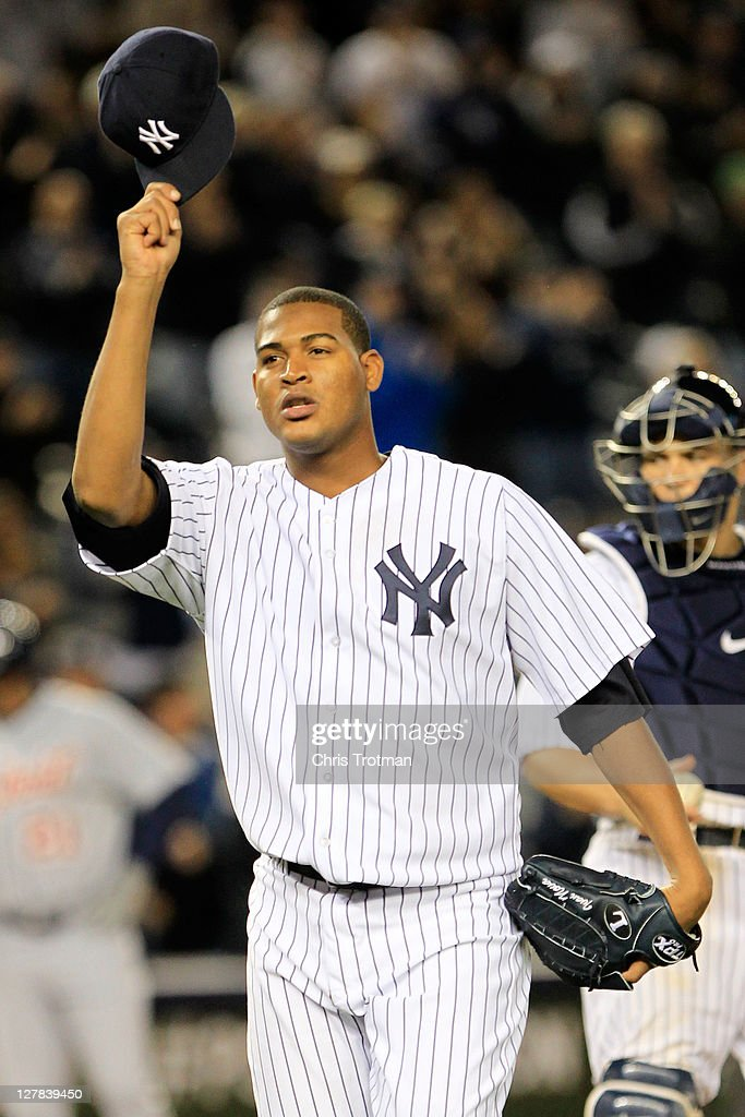 <a gi-track='captionPersonalityLinkClicked' href=/galleries/search?phrase=Ivan+Nova&family=editorial&specificpeople=5743486 ng-click='$event.stopPropagation()'>Ivan Nova</a> #47 of the New York Yankees salutes the crowd after being pulled from the game in the ninth inning of Game One of the American League Division Series at Yankee Stadium on October 1, 2011 in New York City.