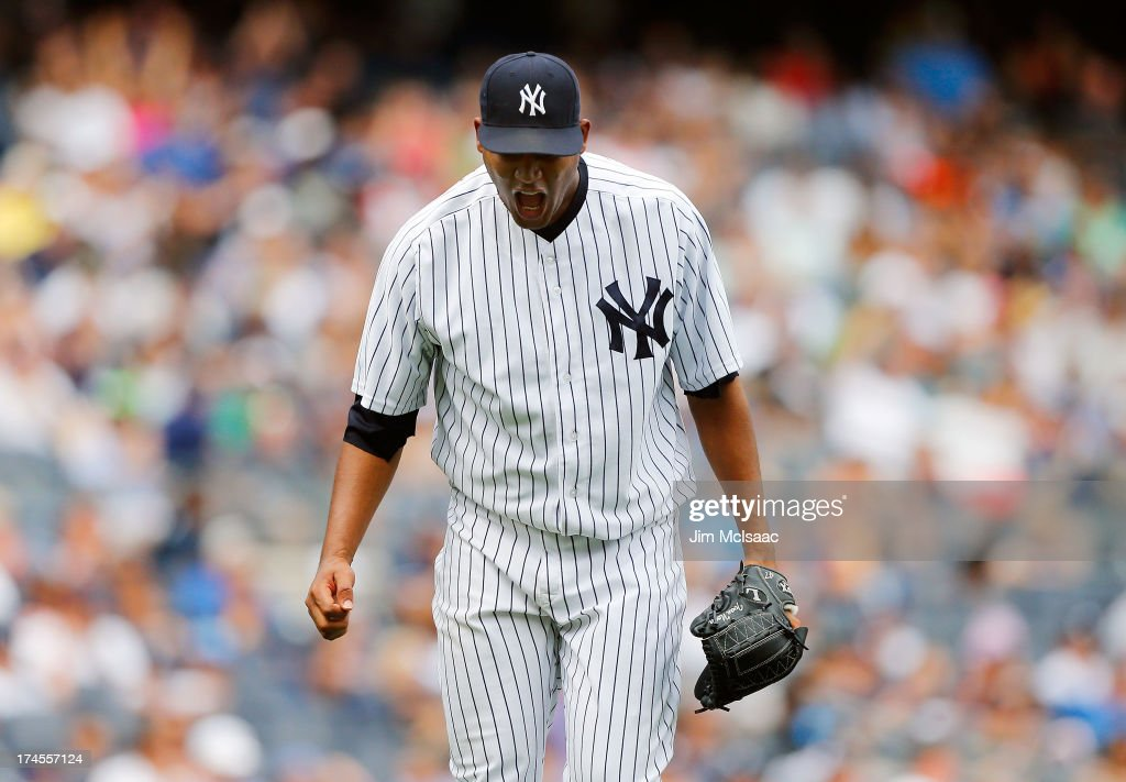 <a gi-track='captionPersonalityLinkClicked' href=/galleries/search?phrase=Ivan+Nova&family=editorial&specificpeople=5743486 ng-click='$event.stopPropagation()'>Ivan Nova</a> #47 of the New York Yankees screams at himself after the sixth inning in which he surrendered the only run of the Tampa Bay Rays 1-0 victory at Yankee Stadium on July 27, 2013 in the Bronx borough of New York City.