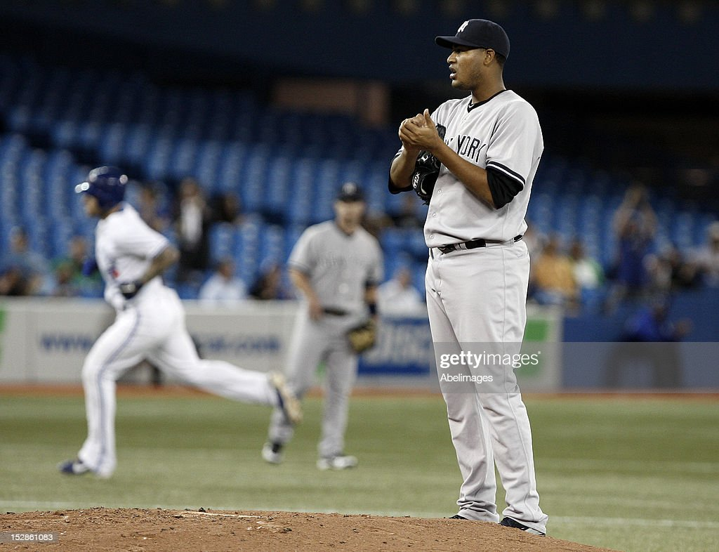 <a gi-track='captionPersonalityLinkClicked' href=/galleries/search?phrase=Ivan+Nova&family=editorial&specificpeople=5743486 ng-click='$event.stopPropagation()'>Ivan Nova</a> #47 of the New York Yankees stands on the mound after giving up a two-run home run to Brett Lawrie of the Toronto Blue Jays during MLB action at the Rogers Centre September 27, 2012 in Toronto, Ontario, Canada.