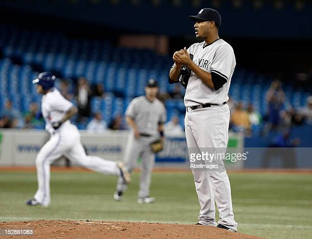 Ivan Nova of the New York Yankees stands on the mound after giving up a tworun home run to Brett Lawrie of the Toronto Blue Jays during MLB action at...