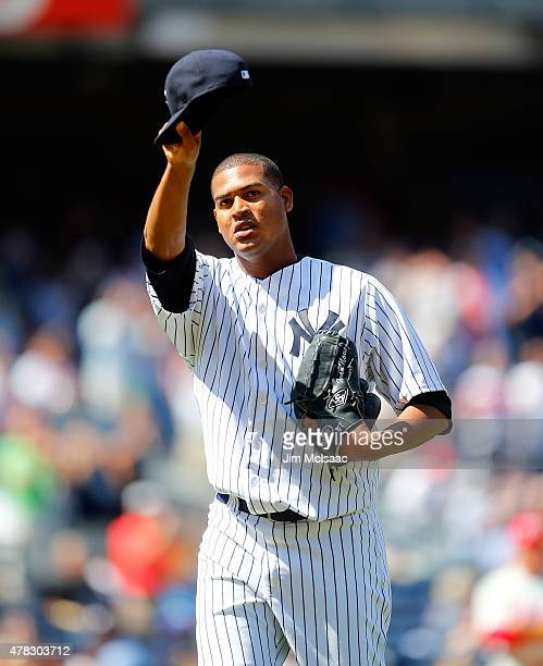 Ivan Nova of the New York Yankees tips his cap to the crowd as he leaves a game in the seventh inning against the Philadelphia Phillies at Yankee...