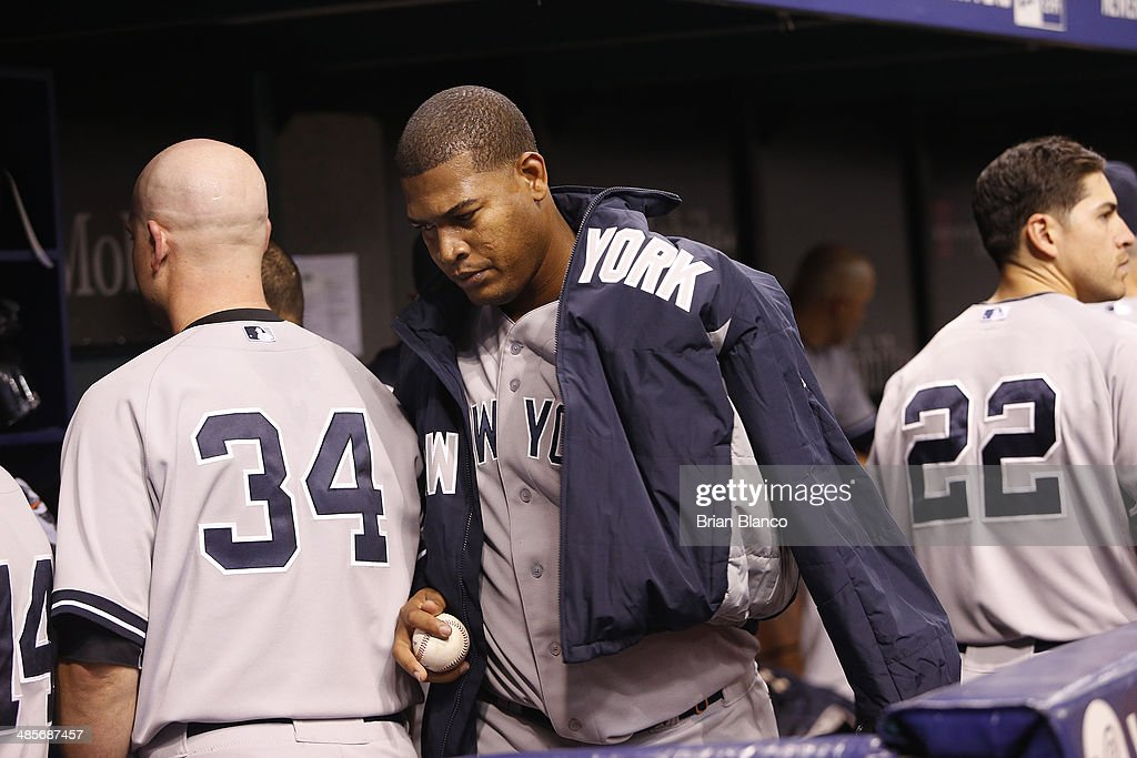 <a gi-track='captionPersonalityLinkClicked' href=/galleries/search?phrase=Ivan+Nova&family=editorial&specificpeople=5743486 ng-click='$event.stopPropagation()'>Ivan Nova</a> #47 of the New York Yankees walks through the dugout following the fourth inning of a game against the Tampa Bay Rays on April 19, 2014 at Tropicana Field in St. Petersburg, Florida.
