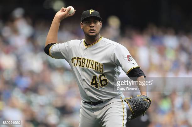 Ivan Nova of the Pittsburgh Pirates makes a throw to first base during the first inning of a game against the Milwaukee Brewers at Miller Park on...