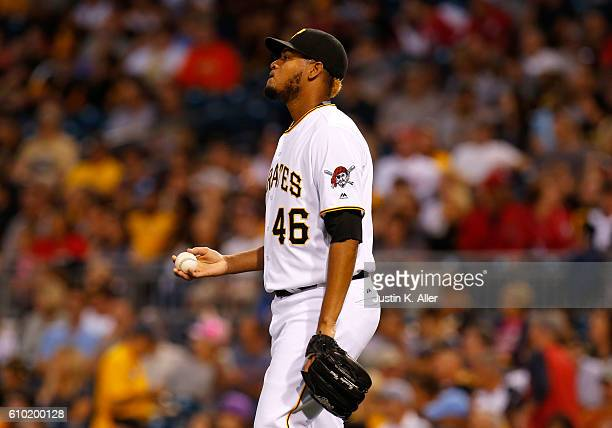 Ivan Nova of the Pittsburgh Pirates reacts after giving up a two RBI single in the first inning during the game against the Washington Nationals at...