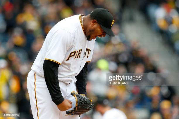 Ivan Nova of the Pittsburgh Pirates reacts in the fourth inning after an inning ending double play against the Atlanta Braves on Opening Day at PNC...