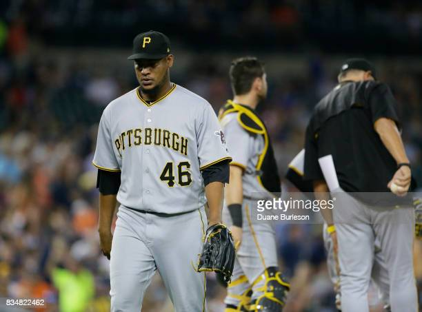 Ivan Nova of the Pittsburgh Pirates walks to the dubious after being pulled from an interleague game against the Detroit Tigers at Comerica Park on...