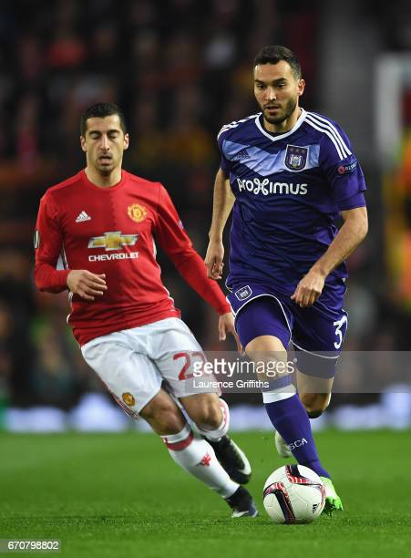 Ivan Obradovic of RSC Anderlecht is chased by Henrikh Mkhitaryan of Manchester United during the UEFA Europa League quarter final second leg match...