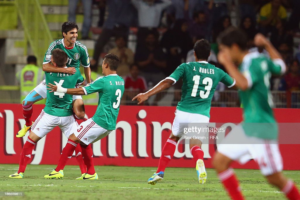 Ivan Ochoa of Mexico celebrates his team's first goal with team mates during the FIFA U-17 World Cup UAE 2013 Quarter Final match between Brazil and Mexico at Al Rashid Stadium on November 1, 2013 in Dubai, United Arab Emirates.