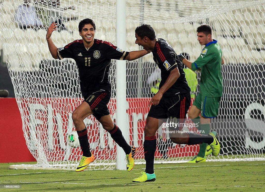Ivan Ochoa of Mexico celebrates scoring a goal during the FIFA U-17 World Cup UAE 2013 Round of 16 match between Italy and Mexico at the Mohamed Bin Zayed Stadium on October 28, 2013 in Abu Dhabi, United Arab Emirates.