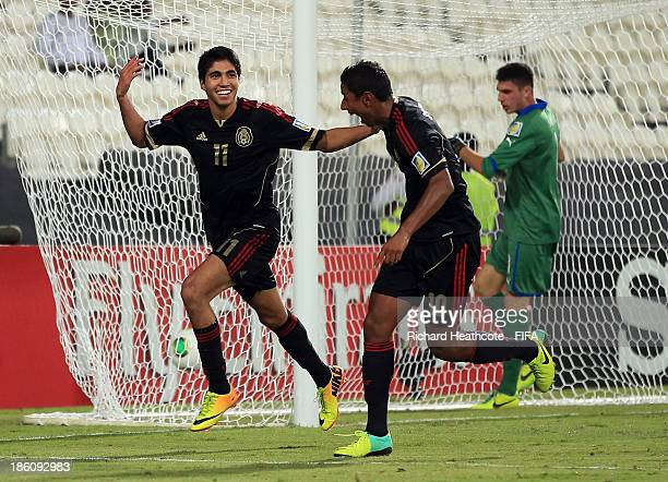 Ivan Ochoa of Mexico celebrates scoring a goal during the FIFA U17 World Cup UAE 2013 Round of 16 match between Italy and Mexico at the Mohamed Bin...