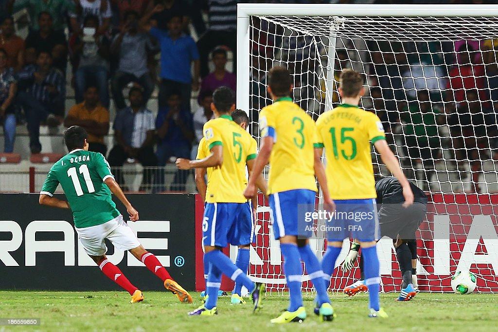 Ivan Ochoa (L) of Mexico scores his team's first goalduring the FIFA U-17 World Cup UAE 2013 Quarter Final match between Brazil and Mexico at Al Rashid Stadium on November 1, 2013 in Dubai, United Arab Emirates.