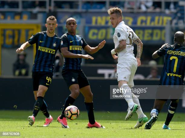 Ivan Perisic and Joao Mario of FC Internazionale competes for the ball with Juraj Kucka of AC Milan during the Serie A match between FC...