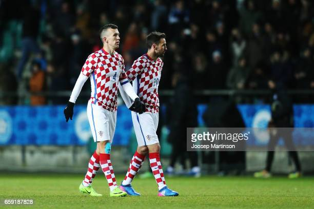 Ivan Perisic and Milan Badelj of Croatia look dejected after international friendly between Estonia and Croatia at A le Coq Arena on March 28 2017 in...