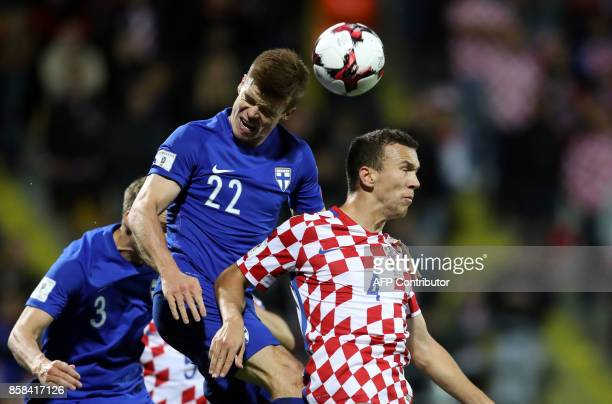 Ivan Perisic from Croatia fights for the ball with Albin Granlund from Finland during the FIFA World Cup 2018 qualification football match between...