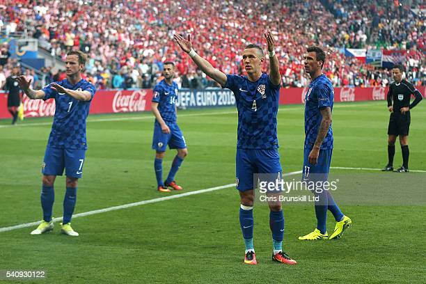 Ivan Perisic of Croatia and teammate Ivan Rakitic appeal for calm during the UEFA Euro 2016 Group D match between the Czech Republic and Croatia at...