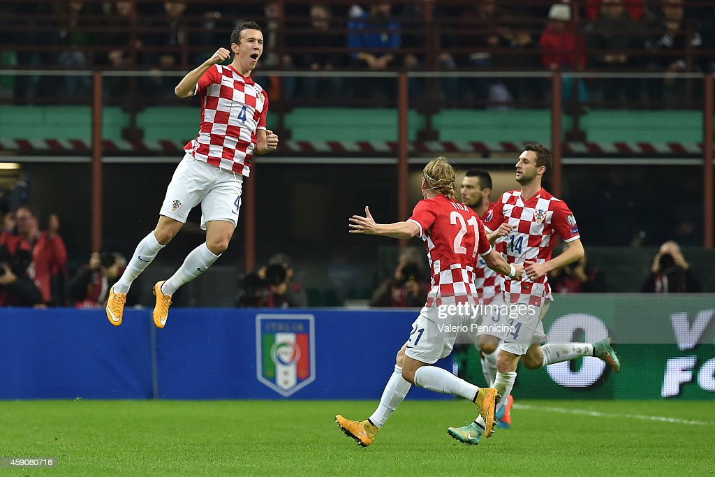 Ivan Perisic (L) of Croatia celebrates his goal during the EURO 2016 Group H Qualifier match between Italy and Croatia at Stadio Giuseppe Meazza on November 16, 2014 in Milan, Italy.