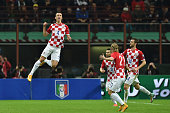 Ivan Perisic of Croatia celebrates his goal during the EURO 2016 Group H Qualifier match between Italy and Croatia at Stadio Giuseppe Meazza on...