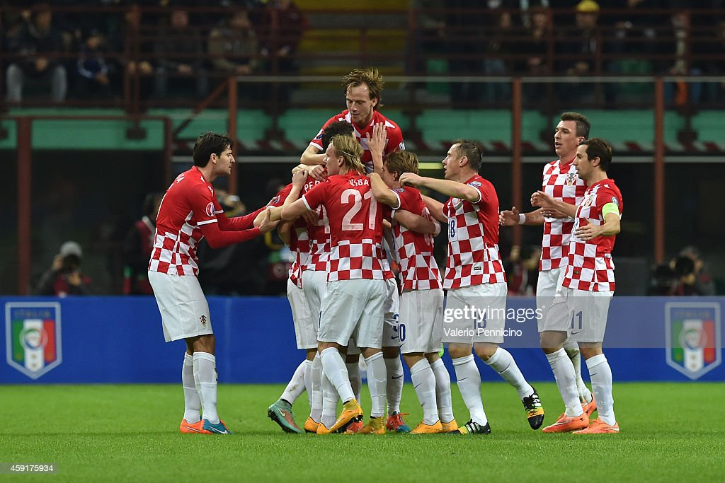 Ivan Perisic of Croatia celebrates his goal with teammates during the EURO 2016 Group H Qualifier match between Italy and Croatia at Stadio Giuseppe...