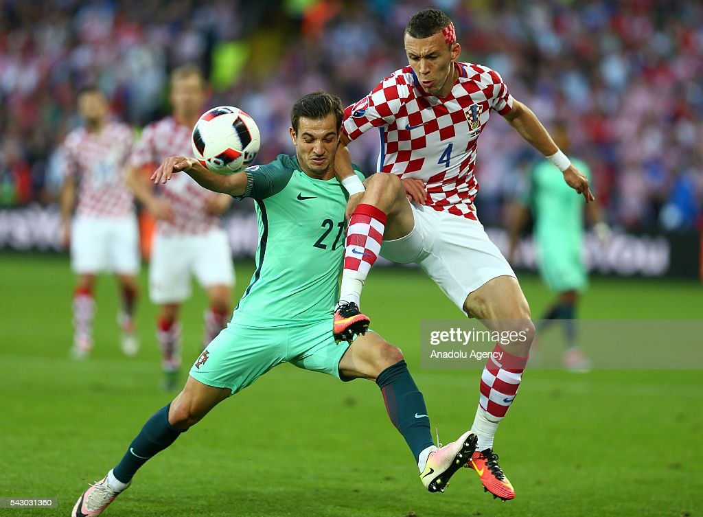 Ivan Perisic (R) of Croatia in action against Cedric (L) of Portugal during the Euro 2016 round of 16 football match between Croatia and Portugal at Stade Bollaert-Delelis in Lens, France on June 25, 2016.
