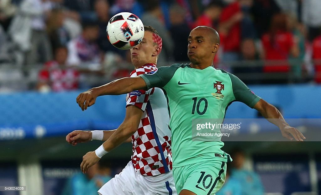 Ivan Perisic (L) of Croatia in action against Joao Mario (R) of Portugal during the Euro 2016 round of 16 football match between Croatia and Portugal at Stade Bollaert-Delelis in Lens, France on June 25, 2016.