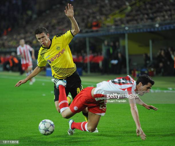 Ivan Perisic of Dortmund is challenged by Ivan Marcano of Olympiacos during the UEFA Champions League group F match between Borussia Dortmund and...
