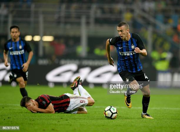 Ivan Perisic of FC Internazionale and André Silva of AC Milan compete for the ball during the Serie A match between FC Internazionale and AC Milan at...
